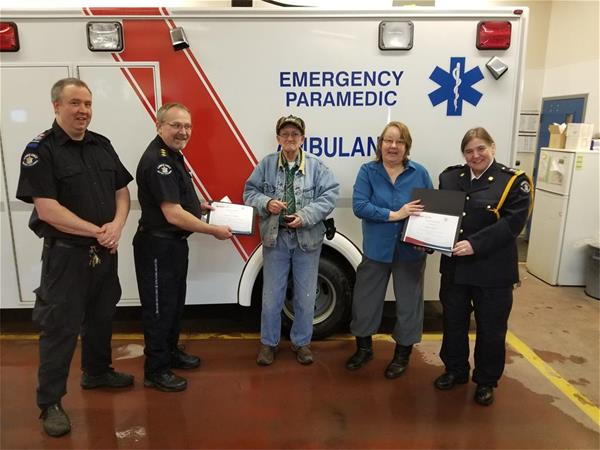 Paramedic Scott Peden; district manager Mike Sorenson; award recipients Barrie and Diana Stephen; unit chief Cheryl Spencer