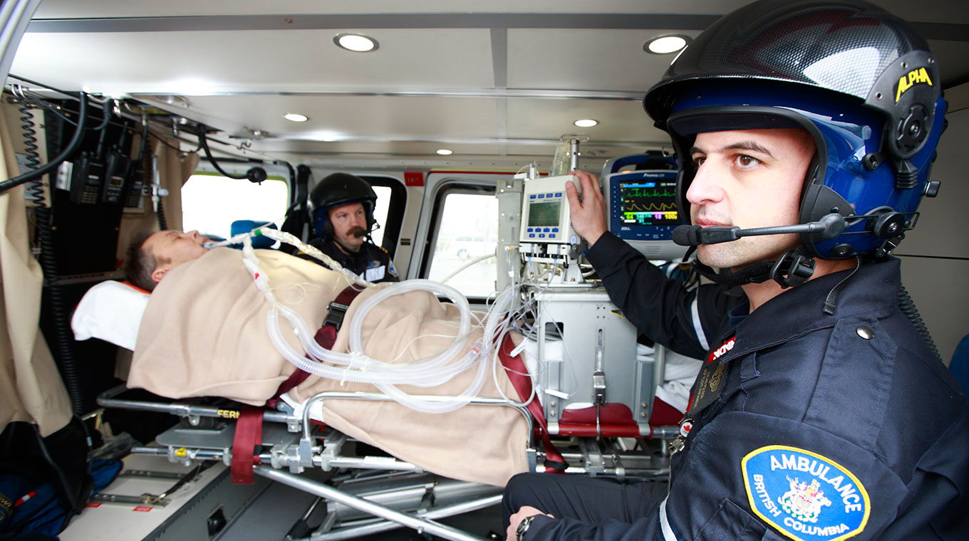 Critical care paramedic transporting a patient