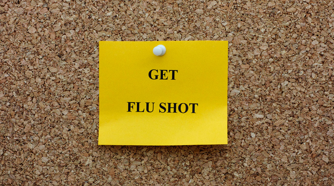 Get flu shot note on corkboard