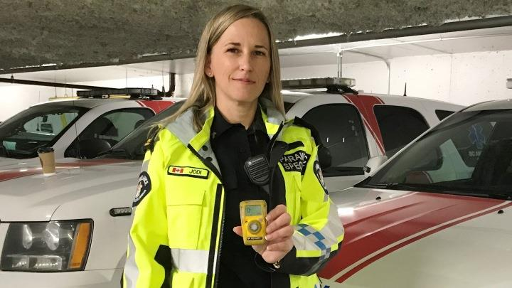 Paramedic specialist Jodi Butterman holds up a portable carbon monoxide monitor