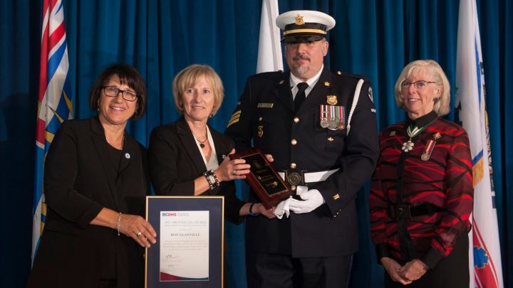 Linda Lupini, COO Barb Fitzsimmons and Lt. Governor Judith Guichon present the COO's Commendation Award to Ron Glanville.